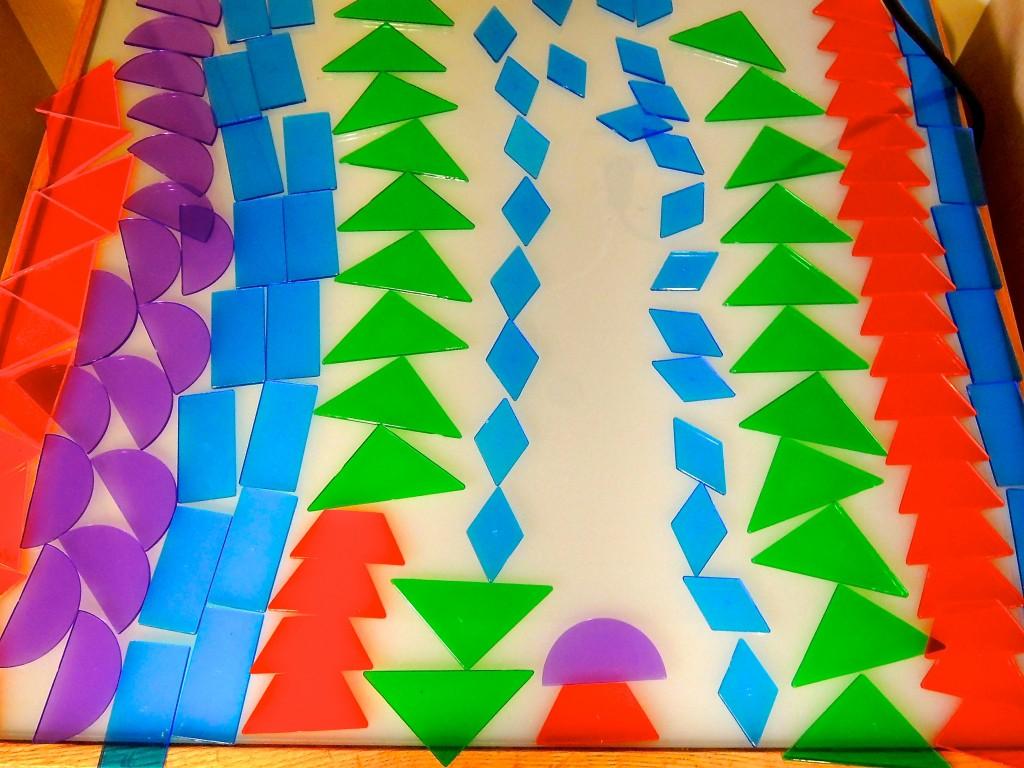 arranging geometric shapes on the light box